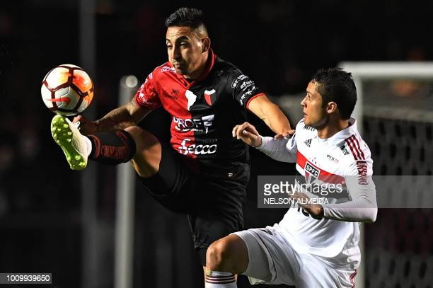 Anderson Martins of Brazils Sao Paulo vies for the ball with Erik Godoy of Argentina's Colon during their 2018 Copa Sudamericana football match held...