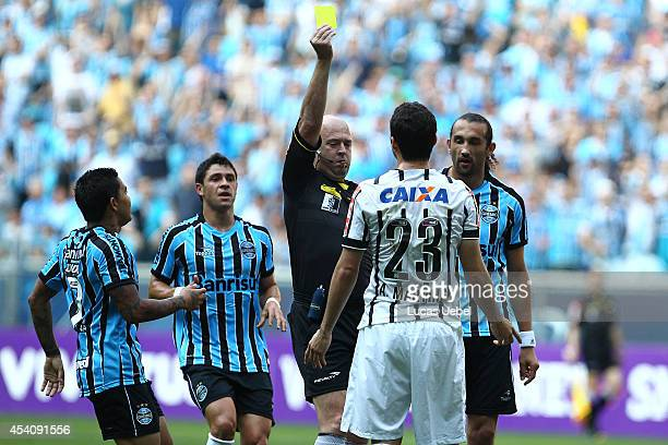 Anderson Martins of Corinthians receives yellow card from the referee Heber Roberto Lopes during the match Gremio v Corinthians as part of...