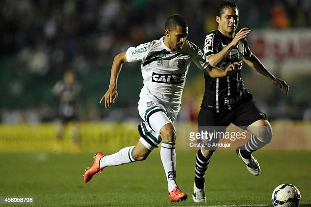 Anderson Martins of Corinthians runs behind Cleyton of Figueirense during a match between Figueirense and Corinthians as part of Campeonato...