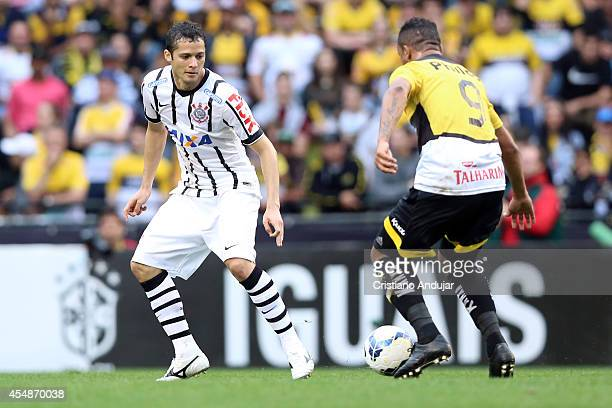 Anderson Martins of Corinthians try to stop Ze Carlos of Criciuma during a match between Criciuma and Corinthians as part of Campeonato Brasileiro...