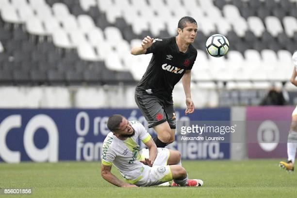 Anderson Martins of Vasco da Gama battles for the ball with Arthur Caike of Chapecoense during the match between Vasco da Gama and Chapecoense as...