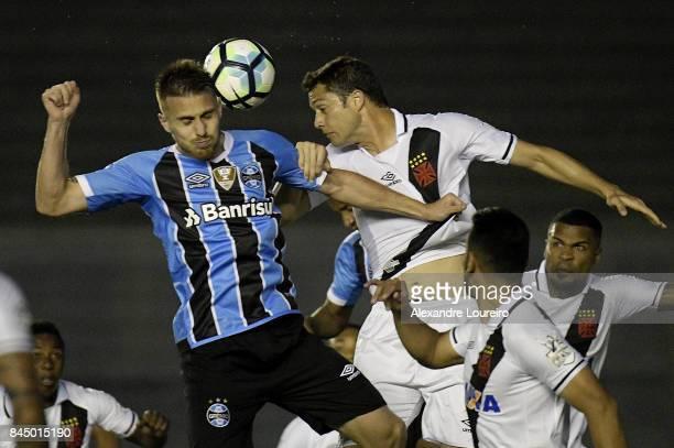 Anderson Martins of Vasco da Gama battles for the ball with Ramiro of Gremio during the match between Vasco da Gama and Gremio as part of Brasileirao...