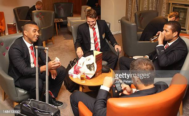 Anderson Nick Powell and Bebe of Manchester United check in for the club's preseason tour of South Africa and China at Manchester Airport on July 16...