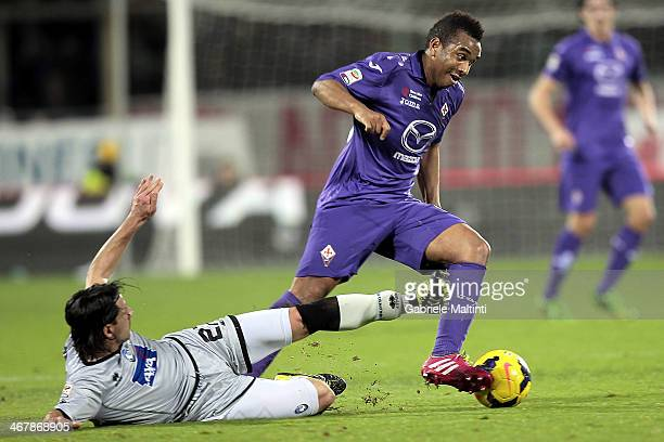 Anderson of ACF Fiorentina fights for the ball with Cristiano Del Grosso of Atalanta BC during the Serie A match between ACF Fiorentina and Atalanta...