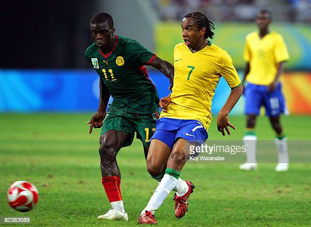 Anderson of Brazil and Gustave Bebbe of Cameroon compete for the ball during the Men's Quarter Final match between Brazil and Cameroon at Shenyang...