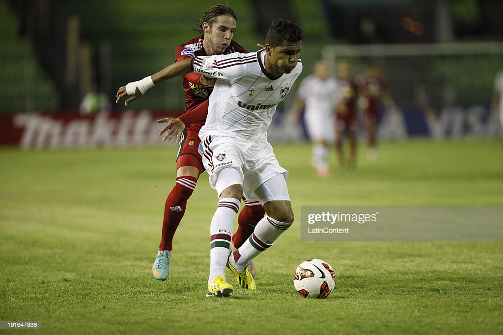 Anderson of Fluminense fights for the ball with Daniel Febes of Caracas FC during a match between Caracas FC and Fluminense as part of the 2013 Copa Bridgestone Libertadores at the Olympic Stadium on February 13, 2013 in Caracas, Venezuela.