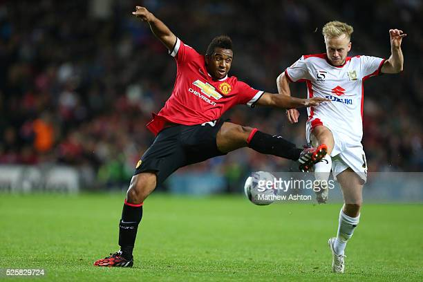 Anderson of Manchester United and Ben Reeves of MK Dons