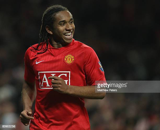 Anderson of Manchester United celebrates Carlos Tevez scoring their fourth goal during the Carling Cup QuarterFinal match between Manchester United...