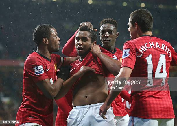 Anderson of Manchester United celebrates his part in Javier 'Chicharito' Hernandez scoring their third goal during the Barclays Premier League match...
