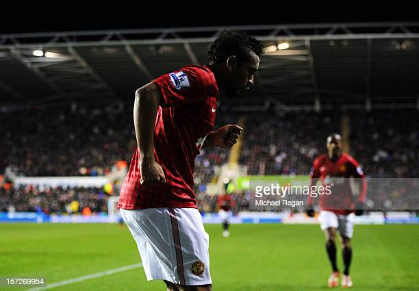 Anderson of Manchester United celebrates scoring a goal with teammate Ashley Young during the Barclays Premier League match between Reading and...