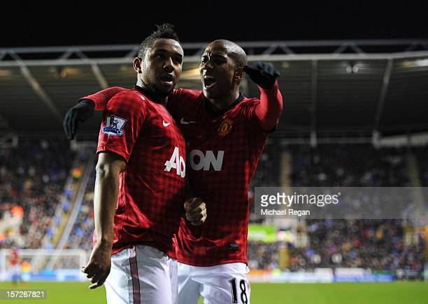 Anderson of Manchester United celebrates scoring with teammate Ashley Young during the Barclays Premier League match between Reading and Manchester...
