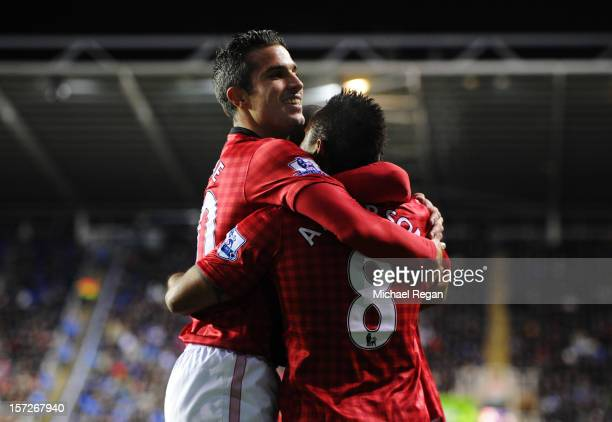 Anderson of Manchester United celebrates scoring with teammate Robin van Persie during the Barclays Premier League match between Reading and...