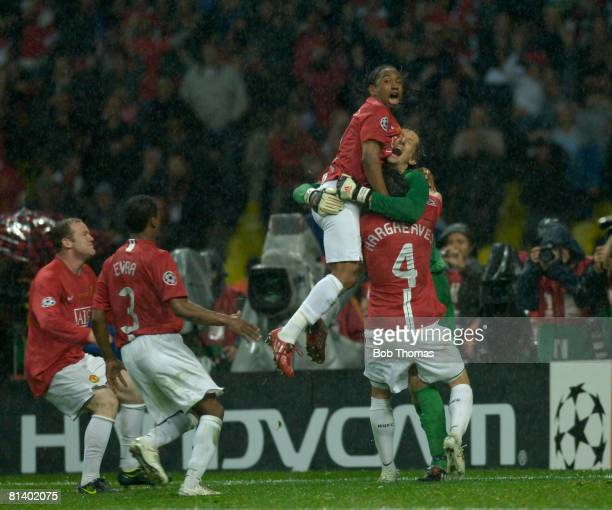 Anderson of Manchester United celebrates victory with teammates Edwin Van Der Sar and Owen Hargreaves after the UEFA Champions League Final between...