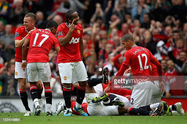 Anderson of Manchester United celebrates with team mates after Wayne Rooney scores his side's third goal during the Barclays Premier League match...