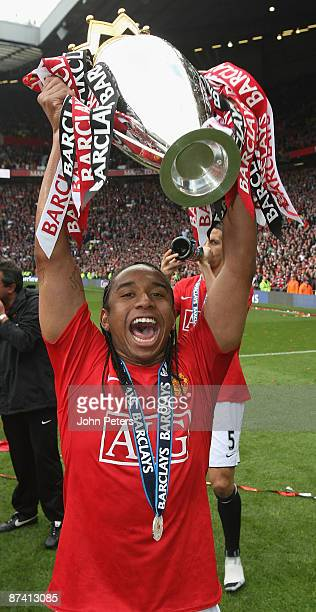 Anderson of Manchester United celebrates with the Premier League trophy after the Barclays Premier League match between Manchester United and Arsenal...