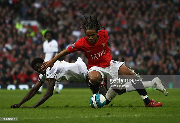 Anderson of Manchester United challenges Emmanuel Adebayor of Arsenal during the Barclays Premier League match between Manchester United and Arsenal...