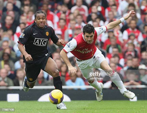 Anderson of Manchester United clashes with Cesc Fabregas of Arsenal during the Barclays FA Premier League match between Arsenal and Manchester United...