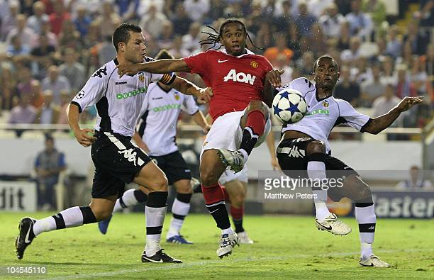 Anderson of Manchester United clashes with David Navarro and Luis Miguel of Valencia during the UEFA Champions League Group C match between Valencia...
