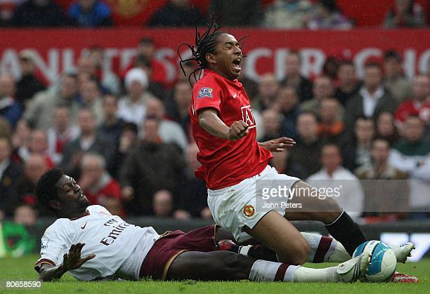 Anderson of Manchester United clashes with Emmanuel Adebayor of Arsenal during the Barclays FA Premier League match between Manchester United and...