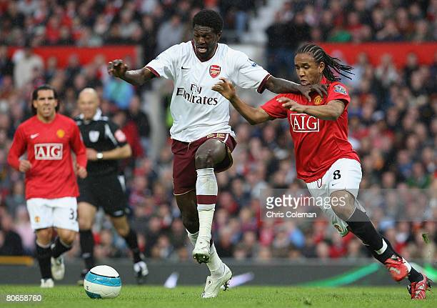 Anderson of Manchester United clashes with Emmanuel Adebayor of Arsenal during the FA Premier League match between Manchester United and Arsenal at...