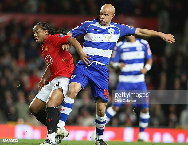 Anderson of Manchester United clashes with Gavin Mahon of Queens Park Rangers during the Carling Cup Fourth Round match between Manchester United and...