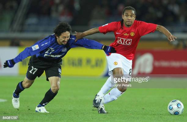 Anderson of Manchester United clashes with Hideo Hashimoto of Gamba Osaka during the FIFA World Club Cup SemiFinal match between Gamba Osaka and...