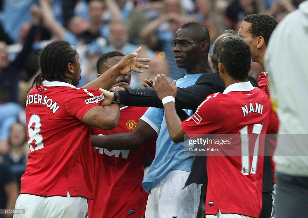 Anderson of Manchester United clashes with Mario Balotelli of Manchester City after final whistle of the FA Cup sponsored by E.on Semi-Final match between Manchester United and Manchester City at Wembley Stadium on April 16, 2011 in London, England.