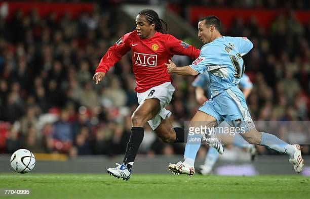 Anderson of Manchester United clashes with Michael Mifsud of Coventry City during the Carling Cup match between Manchester United and Coventry City...