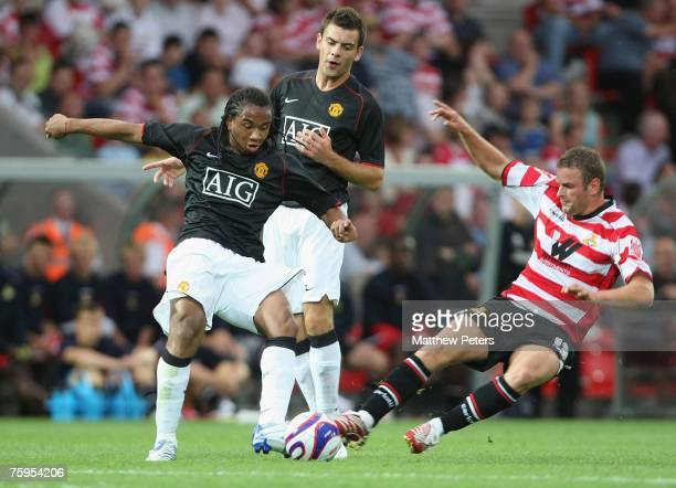 Anderson of Manchester United clashes with Richard Wellens of Doncaster Rovers during the preseason friendly match between Doncaster Rovers and...