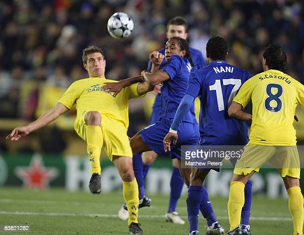 Anderson of Manchester United clashes with Sebastian Eguren of Villarreal during the UEFA Champions League Group E game between Villarreal and...
