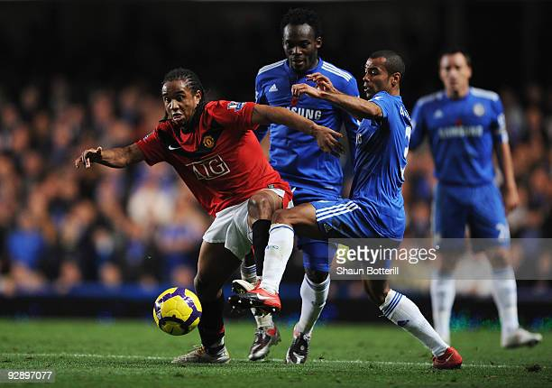 Anderson of Manchester United holds off the challenge from Ashley Cole of Chelsea during the Barclays Premier League match between Chelsea and...