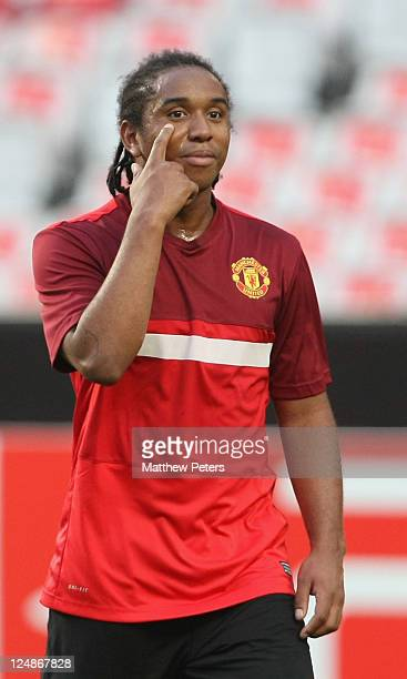 Anderson of Manchester United in action during a first team training session ahead of the UEFA Champions League Group C match against Benfica at the...