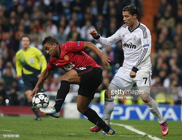 Anderson of Manchester United in action with Cristiano Ronaldo of Real Madrid during the UEFA Champions League Round of 16 first leg match between...