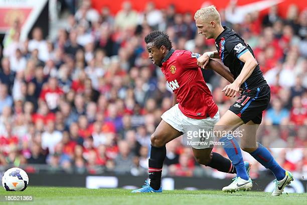 Anderson of Manchester United in action with Dean Moxey of Crystal Palace during the Barclays Premier League match between Manchester United and...