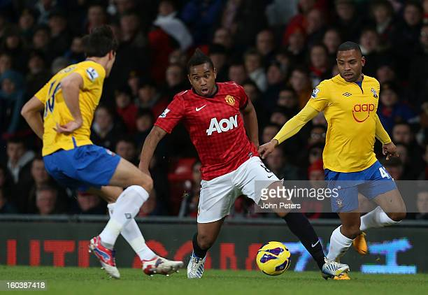 Anderson of Manchester United in action with Jack Cork and Jason Puncheon of Southampton during the Barclays Premier League match between Manchester...