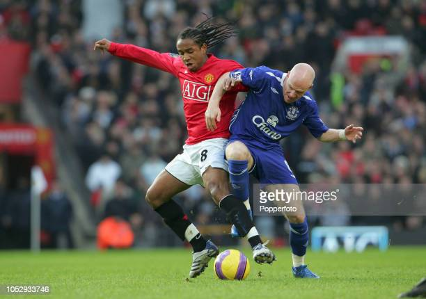 Anderson of Manchester United is challenged by Andy Johnson of Everton during the Barclays Premier League match between Manchester United and Everton...