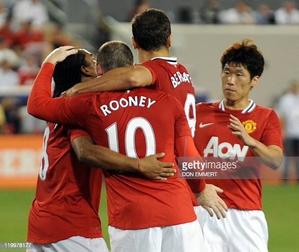Anderson of Manchester United is congratulated by teammates Wayne Rooney Dimtar Berbatov and JiSung Park after Anderson scored a goal in the 20th...
