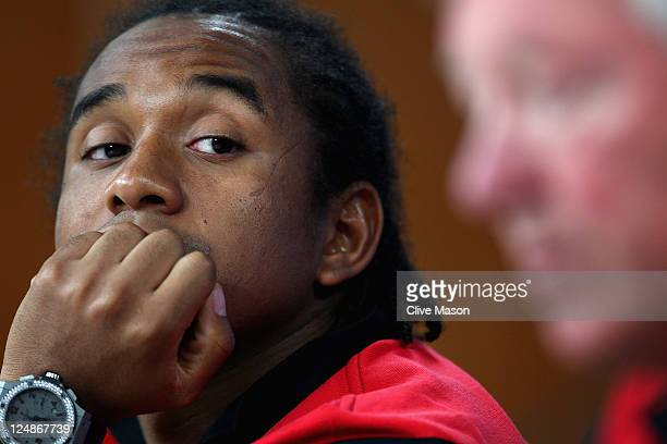 Anderson of Manchester United looks at manager Sir Alex Ferguson during a press conference ahead of the UEFA Champions League Group C match between...