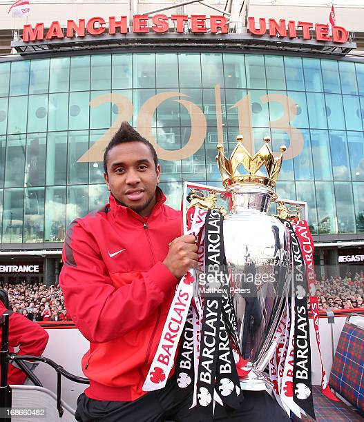 Anderson of Manchester United poses with the Premier League trophy at the start of the Premier League trophy winners parade on May 13 2013 in...