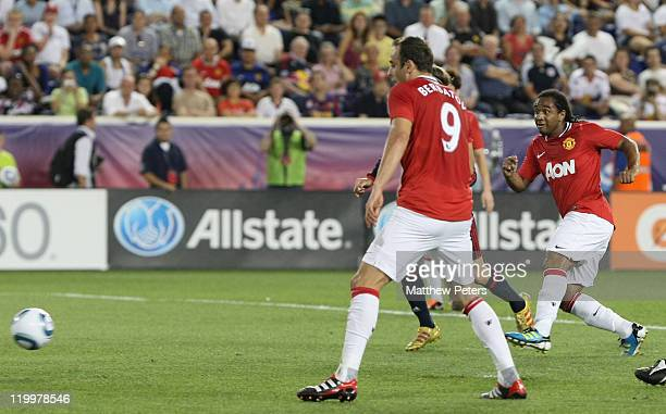 Anderson of Manchester United scores their first goal during the MLS All Star match between MLS All Stars and Manchester United at Red Bull Arena on...