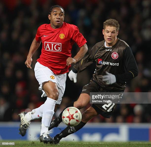 Anderson of Manchester United takes the ball past Kasper Risgard of Aalborg during the UEFA Champions League Group E match between Manchester United...
