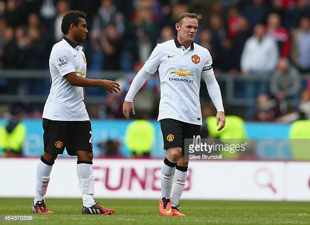 Anderson of Manchester United talks to Wayne Rooney of Manchester United during the Barclays Premier League match between Burnley and Manchester...