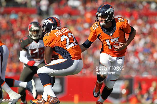 C J Anderson of the Broncos takes the hand off from quarterback Trevor Siemian during the NFL game between the Denver Broncos and Tampa Bay...