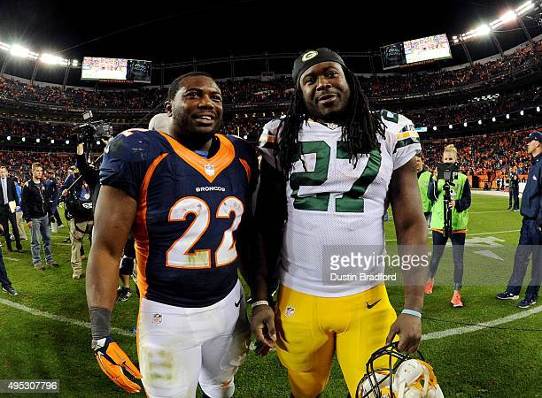 J Anderson of the Denver Broncos and Eddie Lacy of the Green Bay Packers smile together after the Broncos 2910 win at Sports Authority Field at Mile...