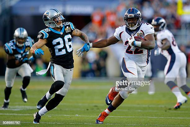 J Anderson of the Denver Broncos carries the ball for 34yards in the second quarter as Cortland Finnegan of the Carolina Panthers defends him during...