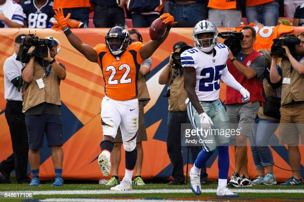 Anderson of the Denver Broncos celebrates a rushing touchdown as Xavier Woods of the Dallas Cowboys reacts during the third quarter on Sunday,...