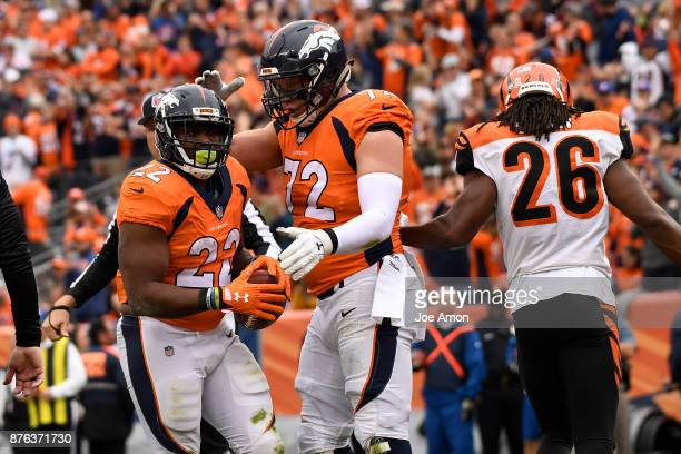 J Anderson of the Denver Broncos celebrates scoring a touchdown with Garett Bolles during the first quarter against the Cincinnati Bengals The Denver...