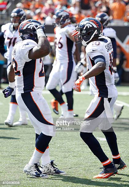 J Anderson of the Denver Broncos congratulates Emmanuel Sanders of the Denver Broncos after scoring a touchdown during the second quarter of the game...