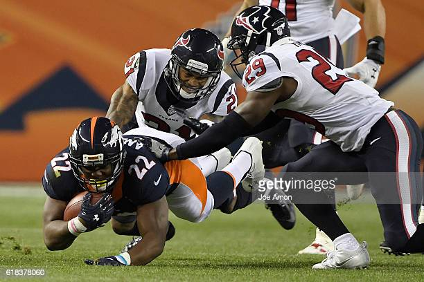 Anderson of the Denver Broncos is tackled by A.J. Bouye of the Houston Texans and Andre Hal during the first quarter on Monday, October 24, 2016....