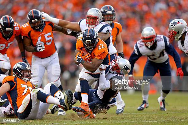 J Anderson of the Denver Broncos runs and is tackled by Patrick Chung of the New England Patriots in the second half in the AFC Championship game at...